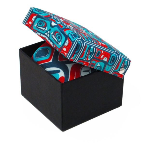 Teal, Blue, and Red Bentwood Box Design on a Silk Tie in box