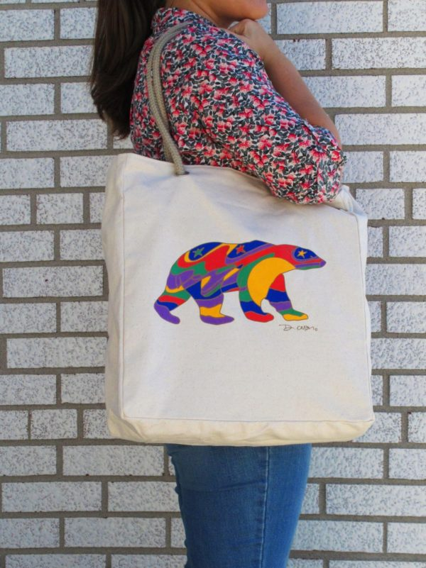 Unbleached plain bag with colourful bear held by model