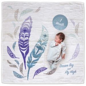 White, blue and purple Feather Baby Blanket. Shows the 1 Month milestone card.