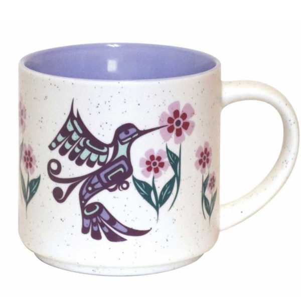 White speckled ceramic with lilac interior. Purple, pink and green Indigenous Hummingbird design.