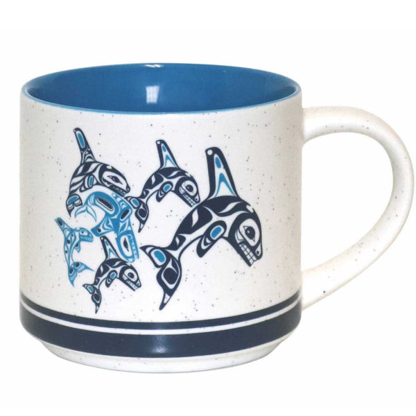 White speckled ceramic with blue interior. Black and blue Indigenous Orca Family design.